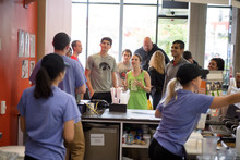 Group of students ordering smoothies.