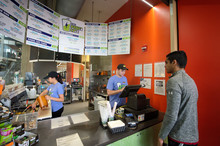 Male student ordering a smoothie.