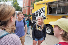 Students standing near food truck
